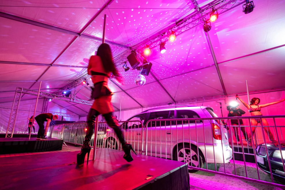 Randy motorists in Germany leer at dancers as they crawl through drive-in STRIP CLUB in Bavaria