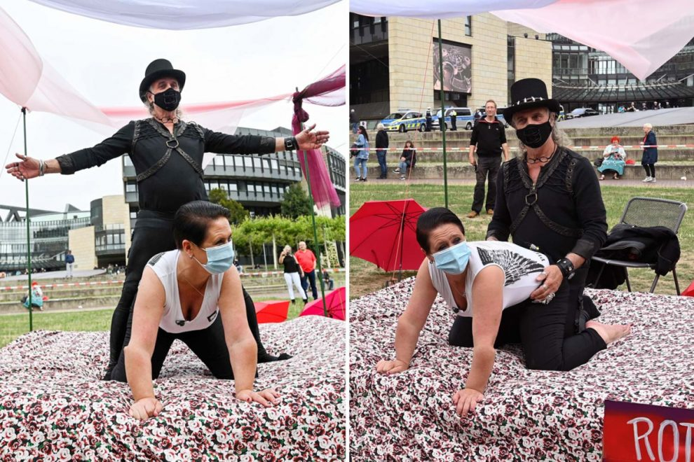 Masked sex workers show how to romp safely during coronavirus in bizarre protest outside German parliament