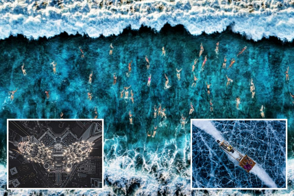 Incredible drone photos show swimmers battling the surf to hundreds of Israeli soldiers social-distancing during drills