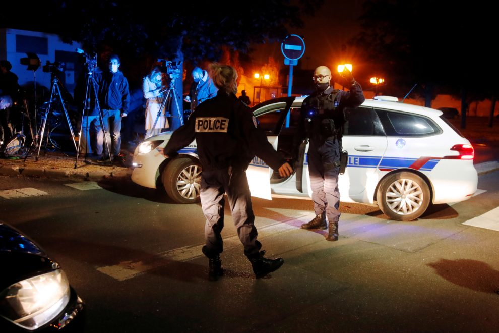 Who was the teacher beheaded near Paris and what happened to the suspect?