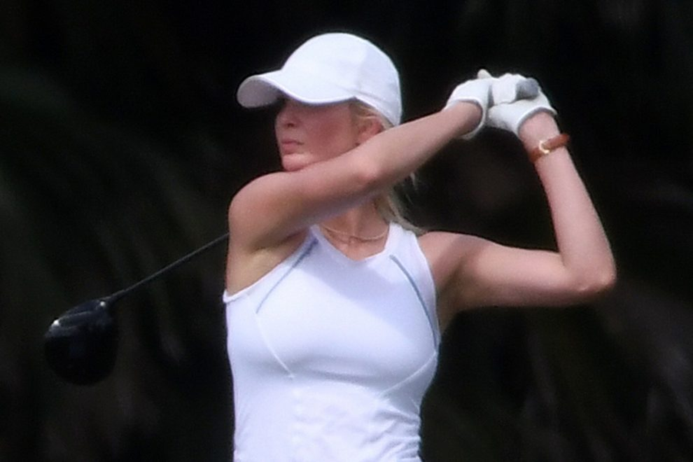 Ivanka Trump shows off her golf swing in all-white outfit – but narrowly misses out on a round with dad