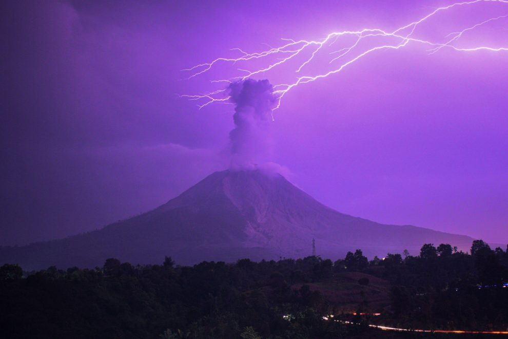 Lightning strikes erupting Mount Sinabung volcano as it spews ash cloud 16,000ft into the sky