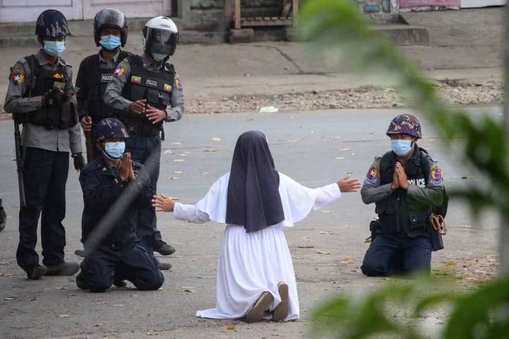 Nun begs on her knees for police to stop shooting protesters in Myanmar