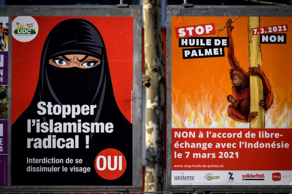 Switzerland votes to ban face coverings including burka and niqab in controversial referendum