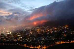 Wildfire on Table Mountain threatens to engulf parts of Cape Town as 250 firefighters battle blaze