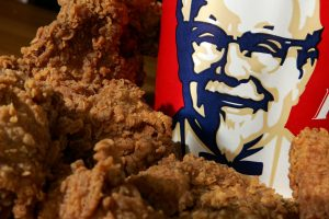 Students jailed for exploiting KFC mobile app glitch to get UNLIMITED amounts of free chicken worth £22,000