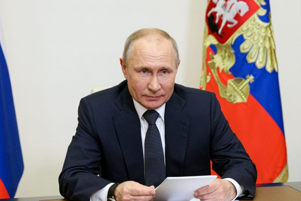 Vladimir Putin warns foreign foes he will 'knock their teeth out' if they try to 'bite' territory away