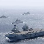 Britain risks China's wrath by sailing biggest warship into South China Sea despite Beijing warning of 'punishment'