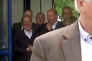 Outrage as German minister is caught LAUGHING when visit town devastated by floods as death toll rises to 143