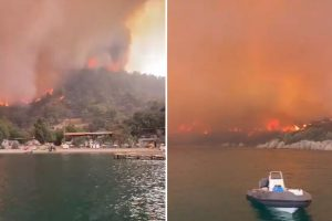 Terrified tourists airlifted & rescued by boats from Brit resorts near Marmaris as wildfires ravage Turkey killing six